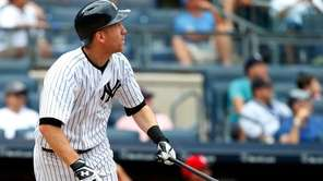 Todd Frazier of the Yankees follows through on