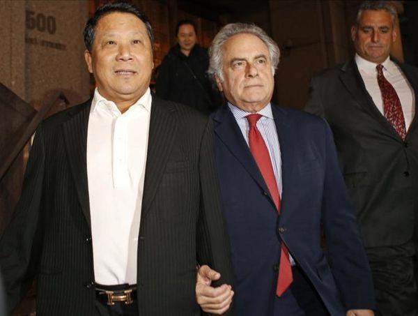 Chinese billionaire Ng Lap Seng, left, leaves federal