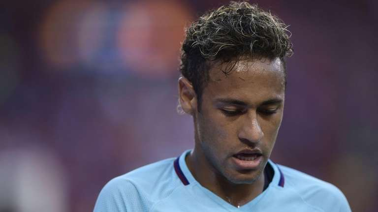 Neymar of Barcelona pauses during a break in