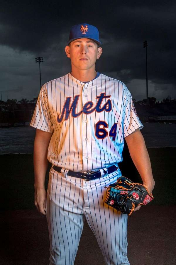 Mets pitcher Chris Flexen poses during photo day