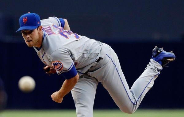 Mets pitcher Steven Matz watches a throw to