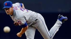 Mets pitcher Steven Matz watches a throw to