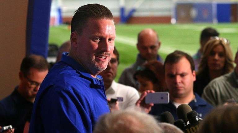 Giants head coach Ben McAdoo speaks to the