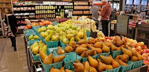 Fruit is displayed in a Whole Foods Market