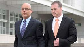 Suffolk Police Officer Christopher McCoy, right, leaves federal