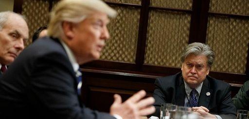 White House Chief Strategist Steve Bannon listens at