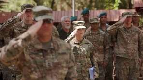 U.S. soldiers salute a change-of-command ceremony earlier this