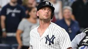 Yankees designated hitter Matt Holliday reacts against the