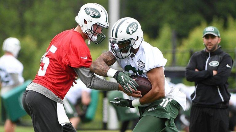 Jets quarterback Christian Hackenberg hands the ball off