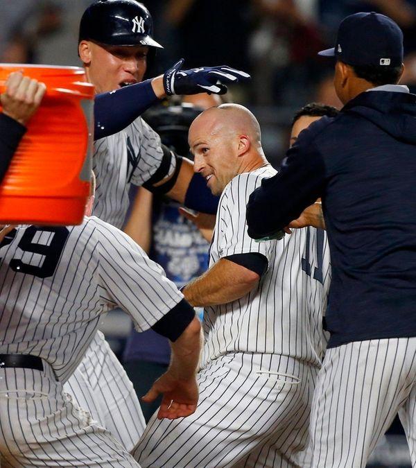 Brett Gardner of the Yankees is mobbed at