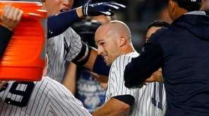 Brett Gardner of the Yankees is mobbed at