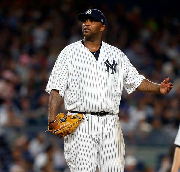 CC Sabathia of theYankees reacts against theRays at