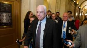 Sen. John McCain (R-Ariz.) is pursued by reporters