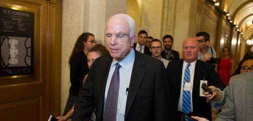 Sen. John McCain (R-Ariz.) is pursued by reporters