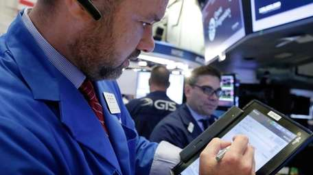 Trader Kevin Lodewick works at the NYSE, Wednesday,