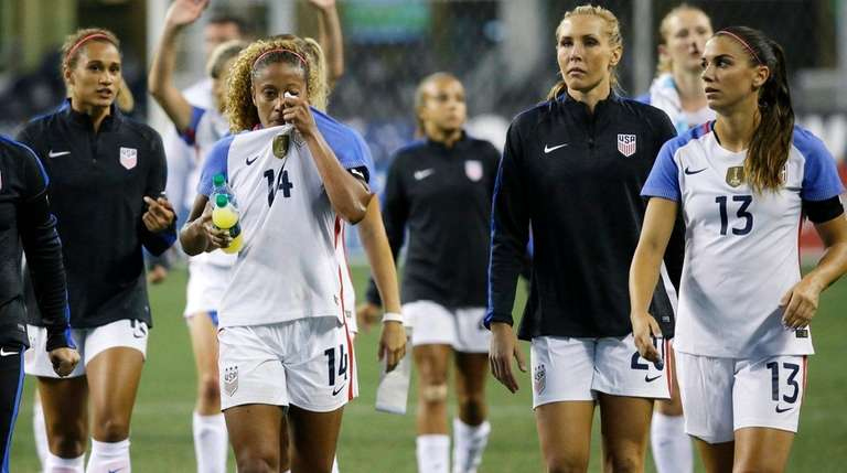 U.S. players walk off the pitch after losing