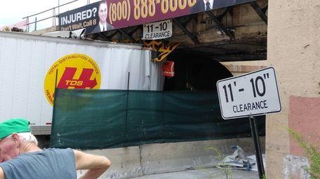 An 18-wheeler struck a 103-year-old railroad bridge in