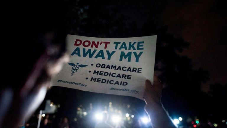 Hundreds of people stood outside the U.S. Capitol
