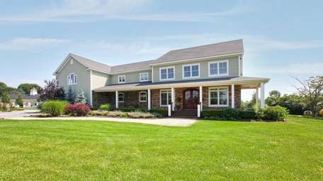 The Calverton home comes with a 12-stall barn.