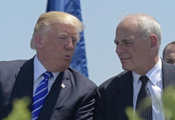 President Donald Trump talks with Homeland Security Secretary