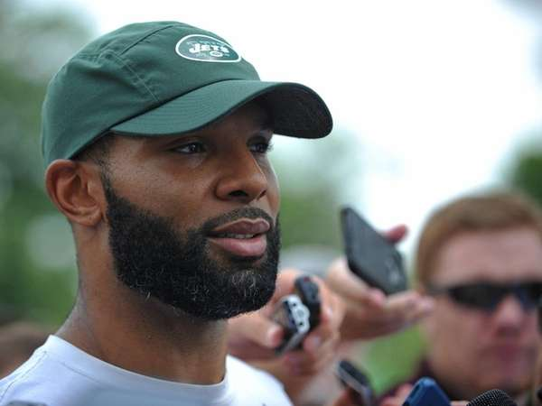 Jets running back Matt Forte speaks with the media
