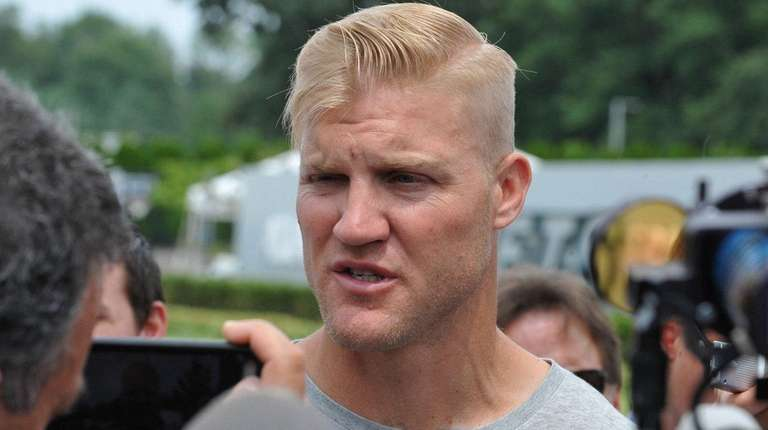 Jets quarterback Josh McCown speaks with the media on