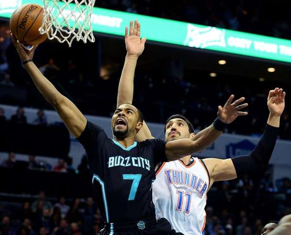 The Charlotte Hornets' Ramon Sessions, left, drives to