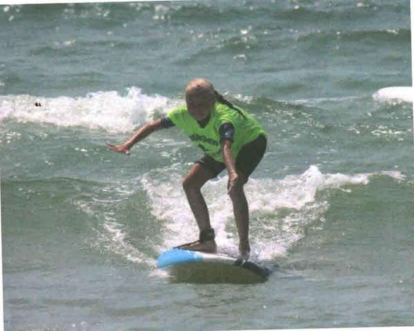 Kidsday reporter Kylie O'Driscoll catches a wave at