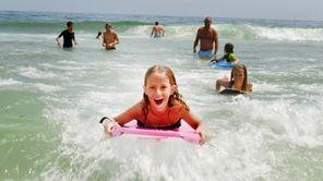Natalie Sandberg, 8, of Sweden, surfs at Coopers