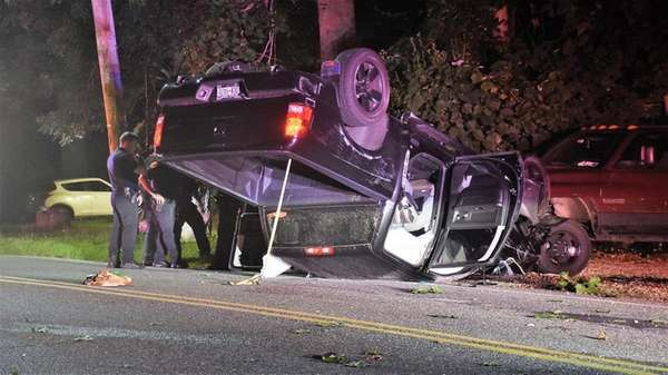 Police respond to a crash involving an overturned