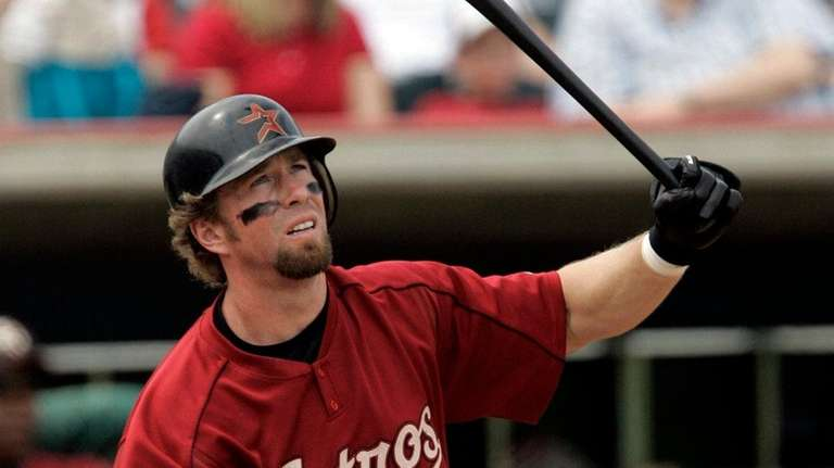 Houston Astros' Jeff Bagwell watches his ball after