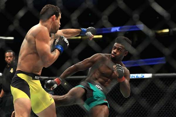 Aljamain Sterling (green shorts) fights Renan Barao of
