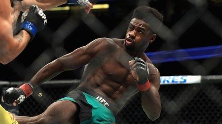Aljamain Sterling (green shorts) fights Renan Barao of