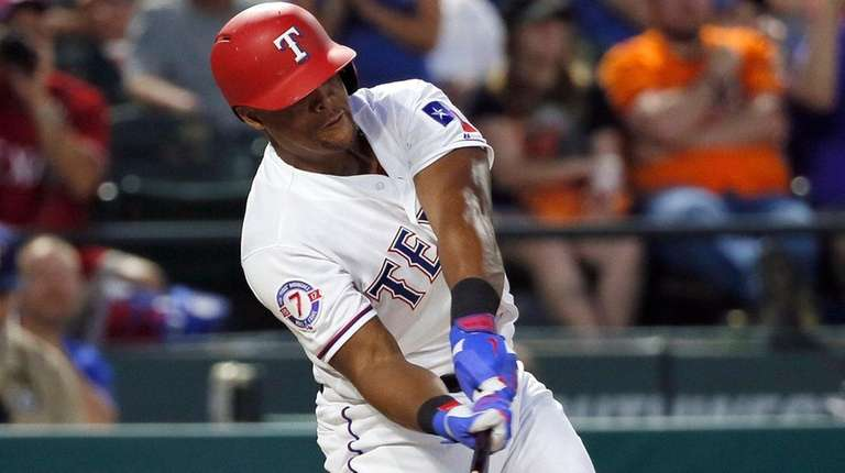 Texas Rangers' Adrian Beltre connects on a pitch