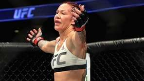 Cris Cyborg of Brazil (L) reacts to defeating