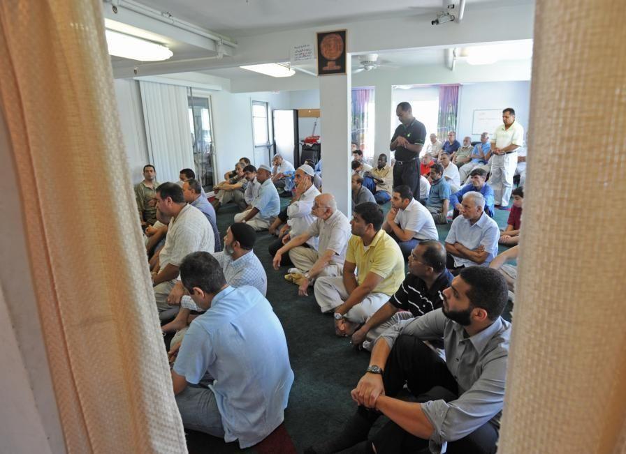 August 14, 2009, Melville: Men praying during the