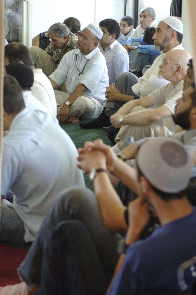 August 14, 2009, Melville: Some men sit in