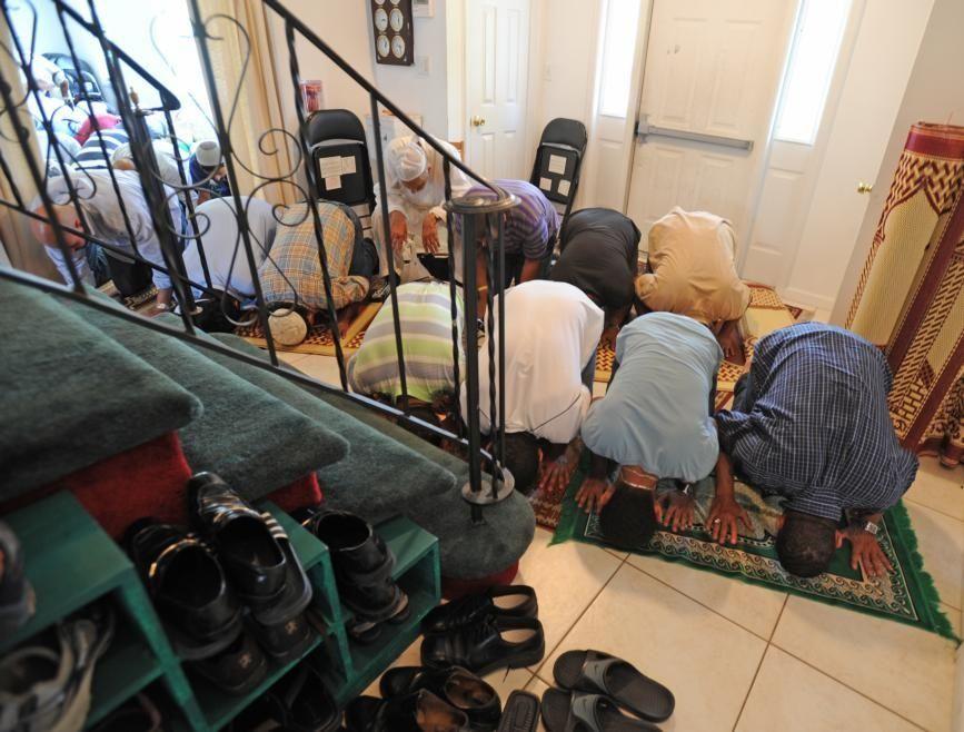 August 14, 2009, Melville: Some men pray in
