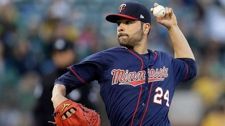 Minnesota Twins pitcher Jaime García works against the
