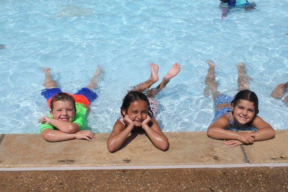 Three Grandchildren having fun at Averill Pool in