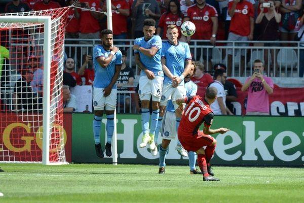 Toronto FC's Sebastian Giovinco scores on a free