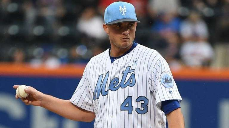 Mets closer Addison Reed stands on the mound