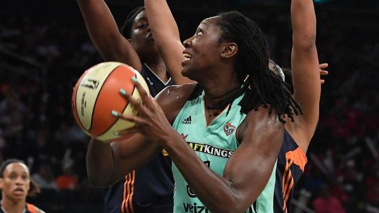 Liberty center Tina Charles takes a shot during