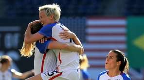 Kelley O'Hara, Megan Rapinhoe, and Becky Sauerbrunn of