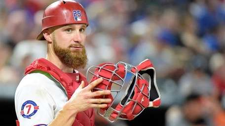 Texas Rangers catcher Jonathan Lucroy looks to the