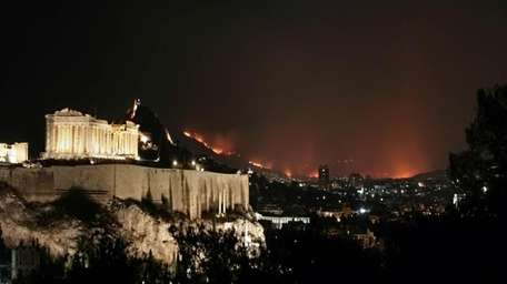 ATHENS, GREECE - AUGUST 23: Wild fire and