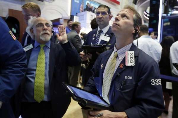 Trader Robert Charmak on the floor of the