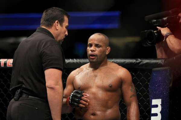 Daniel Cormier is checked by referee John McCarthy