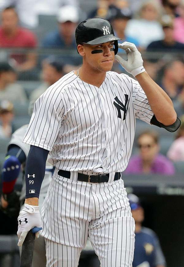 Yankees rightfielder Aaron Judgereacts after striking out inthe