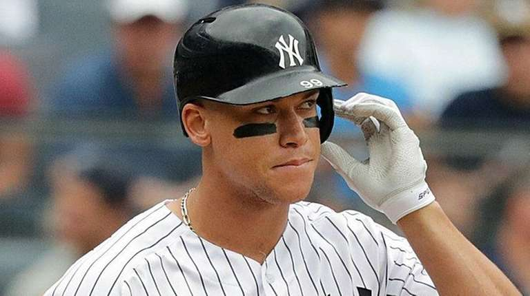 Yankees rightfielder Aaron Judge reacts after striking out inthe